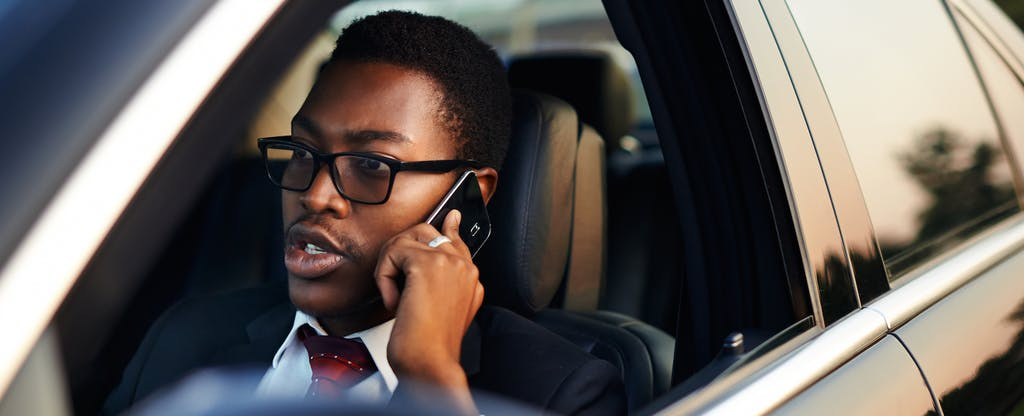 Man drives in car hoping he doesn't have to default on his auto loan