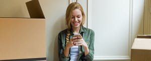 Young blonde woman updating personal information on her credit report