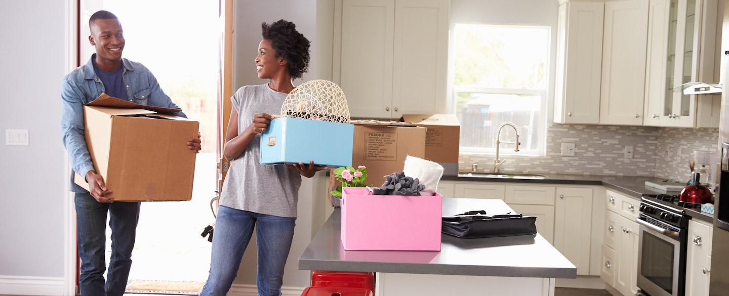Hy Young Carrying Moving Boxes Relieved After Finding A Way To Rent An Apartment
