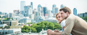 Couple on rooftop contemplates the difficulty of buying a home with bad credit