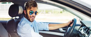 Young man uses car pooling service to help pay off debt