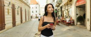 Woman in Bratislava after choosing the best credit cards to use in Europe.
