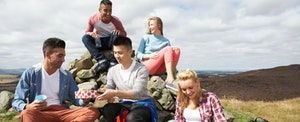 best first credit card for young adults - young adults hiking in mountains