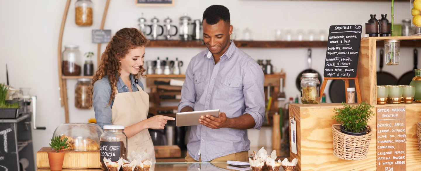 Best credit cards for business owners entrepreneurs in may 2018 a man and a woman behind a coffee shop counter looking at a tablet to learn colourmoves Choice Image