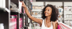 Young woman shopping in a drugstore with the best bank of america credit card for her