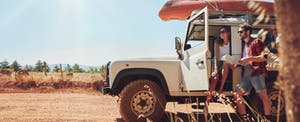 Young couple on a safari adventure paid for by maximizing the benefits of Chase Sapphire Reserve
