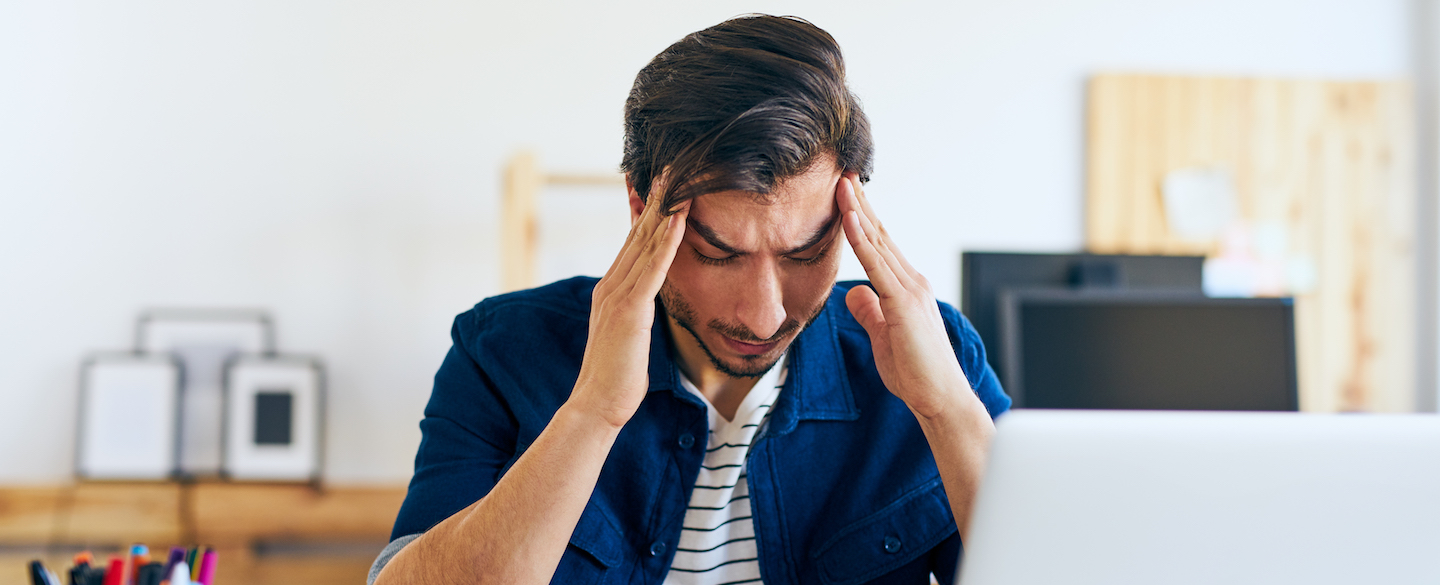Frustrated man massaging his temples as he tries to figure out what to do if a credit dispute didn't work.