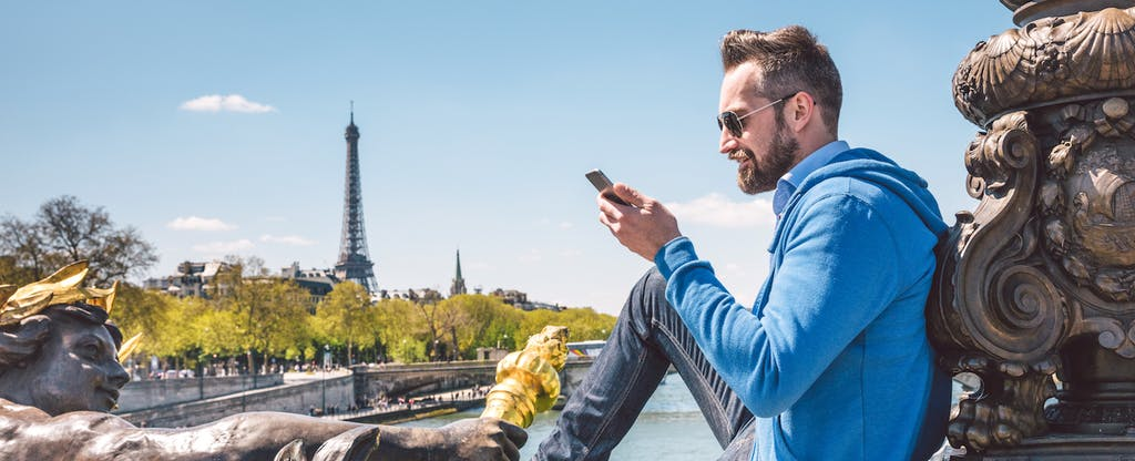 Man on a trip to Paris after maximizing the benefits of the United MileagePlus Explorer Card