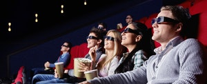 Family wearing 3D glasses to watch a film in a movie theater to help overcome debt fatigue