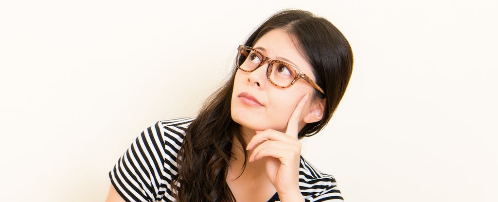 Young, puzzled woman wants to learn about credit score factors