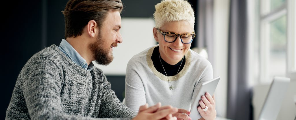 Hip woman explaining credit counseling to a young man