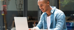 Man looking at his laptop and making good credit decisions