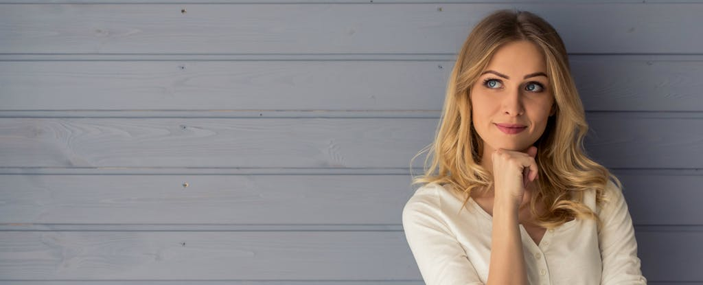 Woman thinking about how to lower her credit card interest rate