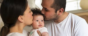 Family with newborn baby girl, wondering how this major life change will affect their taxes.