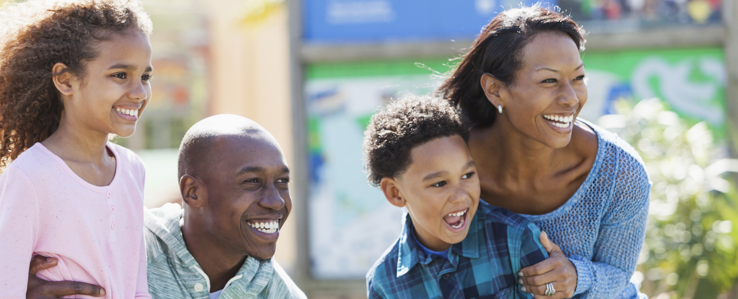 Family at an amusement park, taking advantage of the Disney Rewards Dollars they're earning with their Disney Rewards credit cards from Chase Visa.
