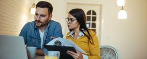 couple looking at mortgage documents