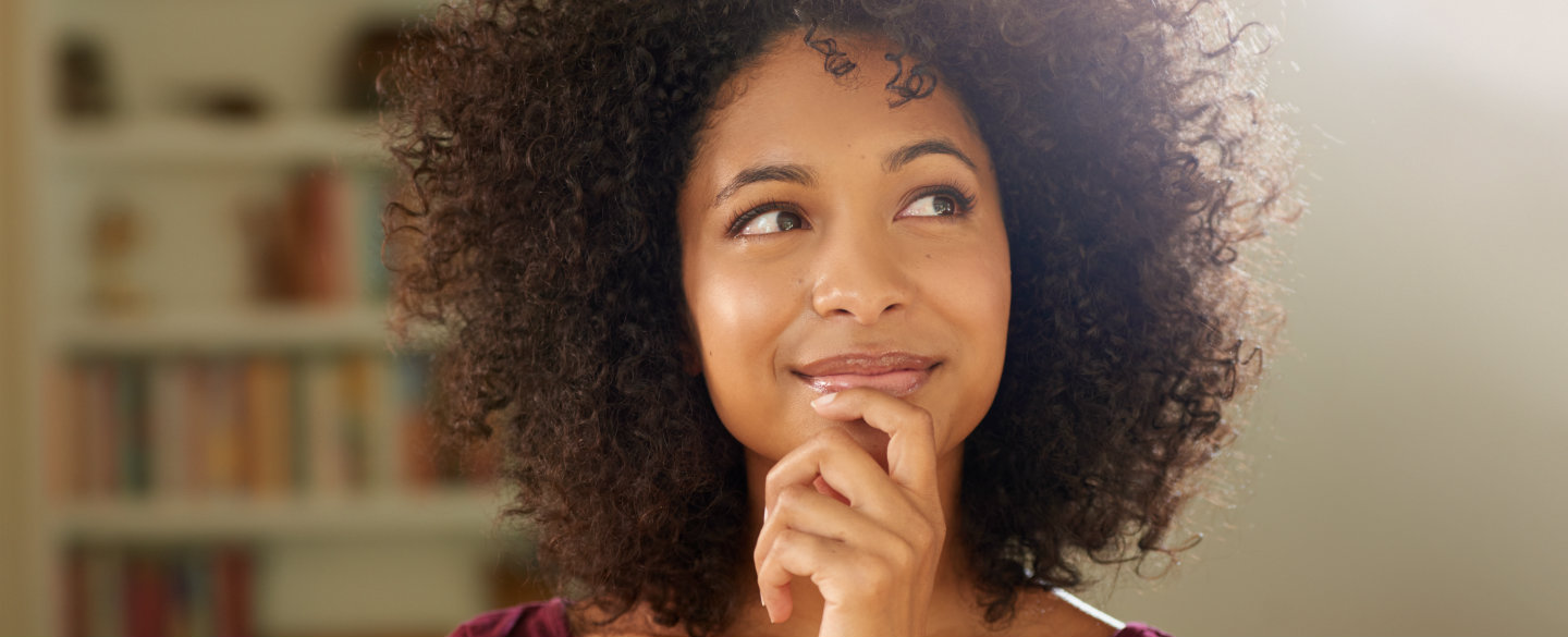 Smiling woman wonders how a balance transfer works