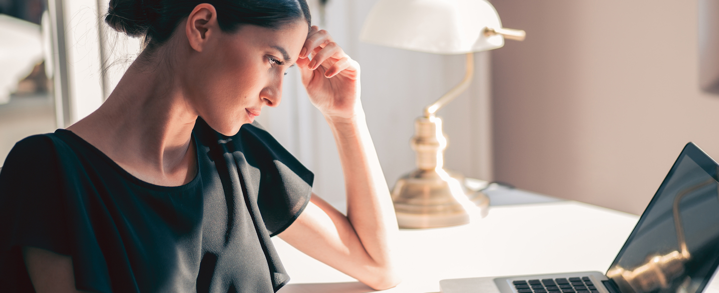woman sitting at desk looking at laptop and wondering how long public records are available