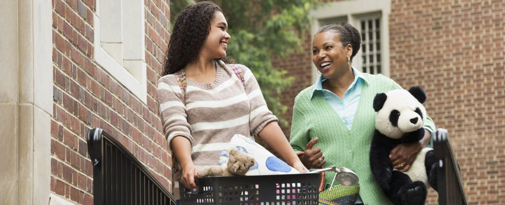 Mother and college-aged daughter benefitting from the American Opportunity Tax Credit (AOTC)