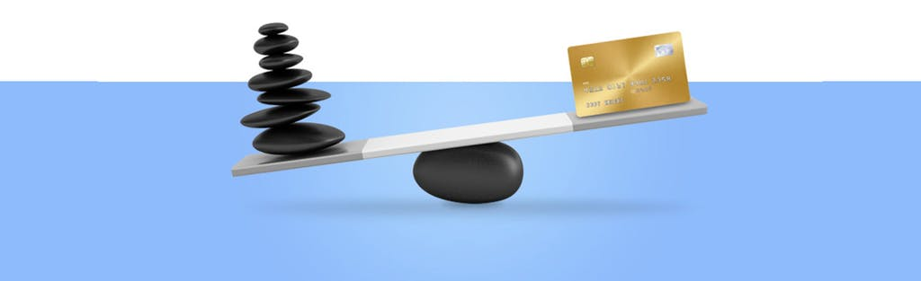 A balance with a credit card on one side and stones representing debt on the other to symbolize the choice you make with balance transfer cards.