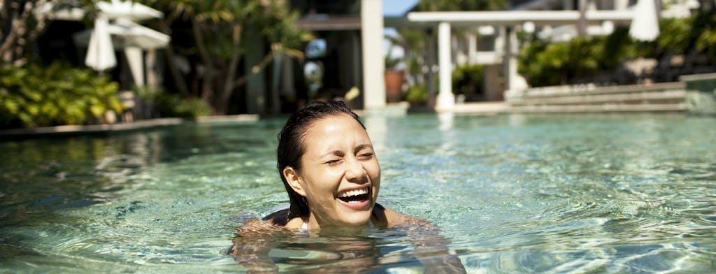 Woman swimming in hotel pool