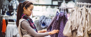 Woman searching for clothes to purchase with her Target REDcard credit card