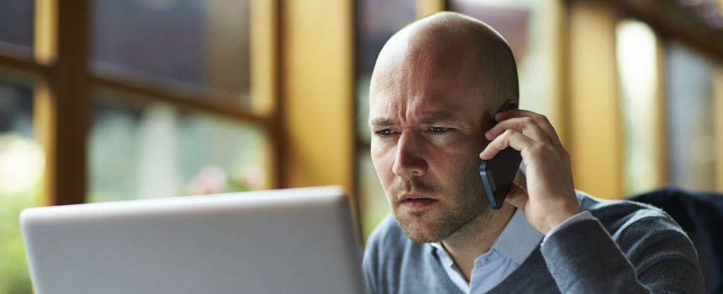 Man looking at a derogatory mark on his credit reports