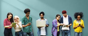 A diverse group of young people against a turquoise backdrop