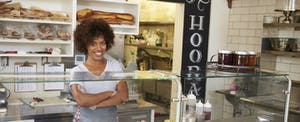 Businesswoman smiles after learning how to get a small-business loan