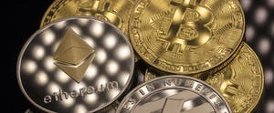 Shadowy close-up of bitcoin, ethereal and litecoin