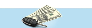 Image of a car key and hundred dollar bills against a light blue background