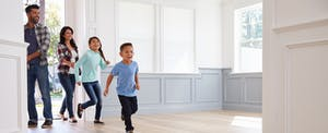 Young family looking a new house that they got after learning the 5 cs of credit