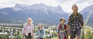 Family hiking on rural hillside