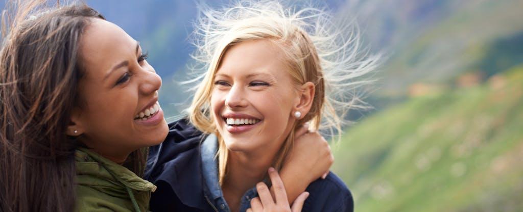 Two women enjoying themselves to represent understanding of VantageScore 3.0 credit scoring model