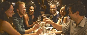 Group of friends enjoying meal in a restaurant