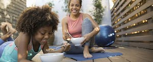 Mother and daughter discuss FICO Score 8 while eating cereal