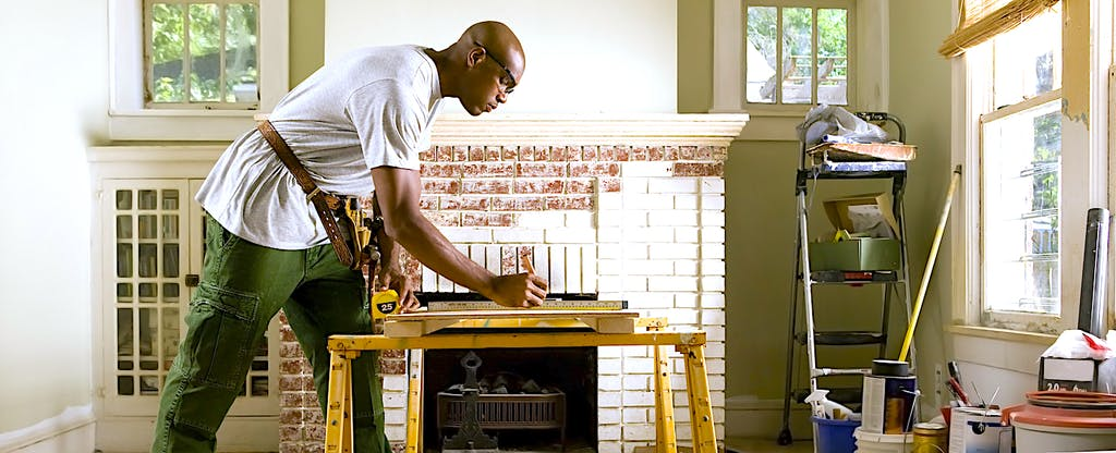 African American man renovating home interior