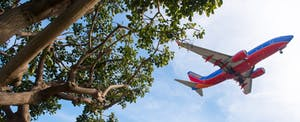 Southwest Airlines aircraft flying over Los Angeles International (LAX) Airport