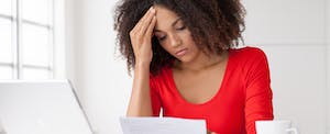 A concerned woman thinks about stress spending habits