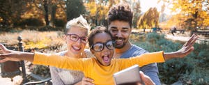 Family taking a funny photo after learning how much a financial adviser costs