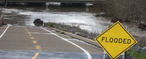 """Flooded roadway with """"flooded"""" sign"""