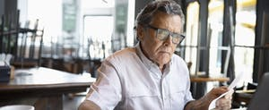A man with gray hair researches how to freeze your credit