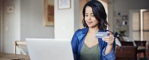 Young woman work from home on her laptop.
