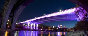 Purple light illuminates the underside of the 35W bridge in Minneapolis, in tribute to one of the city's most famous natives, Prince.