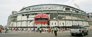 Fans walk to Wrigley Field in Chicago, Illinois.