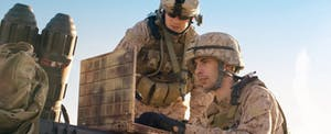 American soldiers serving in the desert, eligible for combat zone tax exclusion on the federal income taxes.