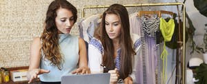 Two women working in clothing store