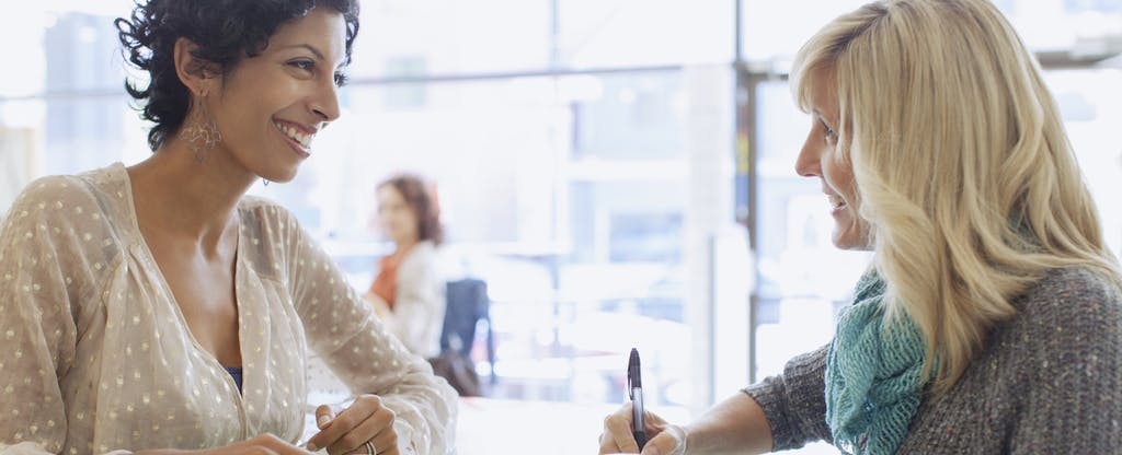 Woman at a bank signing up for a free bank account