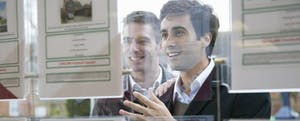 Couple looking into real estate office window