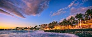 Sunset along Alii Drive on the beach town of Kailua Kona on the Big Island of Hawaii.